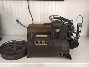 Vintage AMPRO 'Premier 10' 16 mm Sound Projector with case & speaker, reels,and accessories for Sale in Roanoke, TX