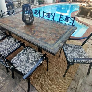 9 PIECES STONE DINNING PATIO SET WITH CUSHIONS ECXELLENT CONDITION for Sale in Spring Valley, CA