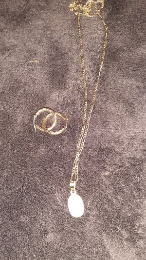 22 inch gold figaro chain with 10 k virgin mary charm and 14 kt hoop earrings real not plated for Sale in Phoenix, AZ