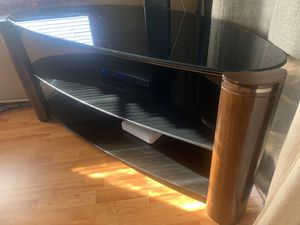 Tv stand brown wood with glass for Sale in Antelope, CA