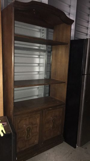Chestnut entertainment center wooden with shelves and storage for Sale in Austin, TX