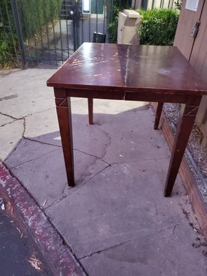 4ft tall table needs refinishingdark wood nice table for Sale in Los Angeles, CA