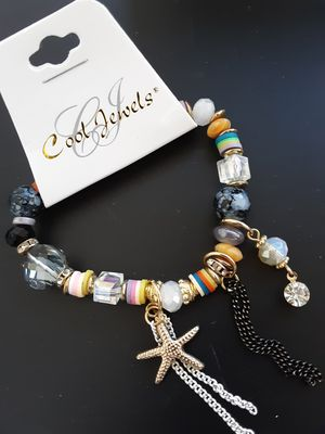 New Cool Jewels goldtone and multi-color bead stretch bracelet with dangling charms for Sale in Anaheim, CA