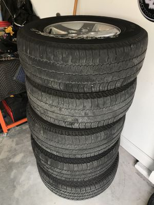 Jeep Wrangler Sport Rims Tires wheels for Sale in Orlando, FL