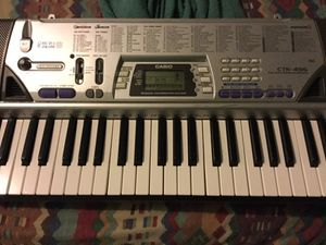 Gray and black electronic keyboard for Sale in Tampa, FL