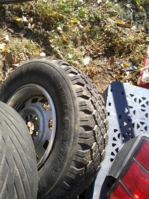 2 1996 to 99 Jeep Cherokee studed tires and wheels for Sale in St. Louis, MO