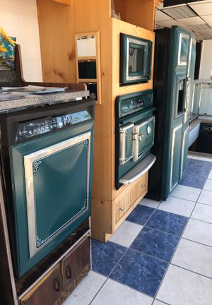 All appliances made by GE with the Elmira Trim. Gorgeous set of 4 appliances. Refrigerator, wall oven, microwave, and dishwasher. The retail price is for Sale in Boston, MA
