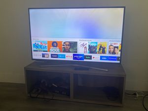 50+ inch 4K Samsung Smart TV w/free TV stand for Sale in Baldwin Hills, CA