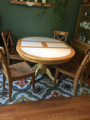 Solid wood dining table with 6 chairs and matching china buffet in good condition. $250 for both . for Sale in Bristow, VA