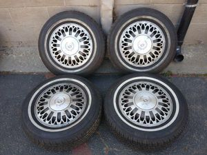 Cadillac 15 inch stock wheels and whitewalls 5 on 115mm Fits chevy for Sale in Montebello, CA