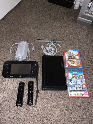 Wii U Console, come two games, two controls and the mini console with charger for Sale in Cape Coral, FL