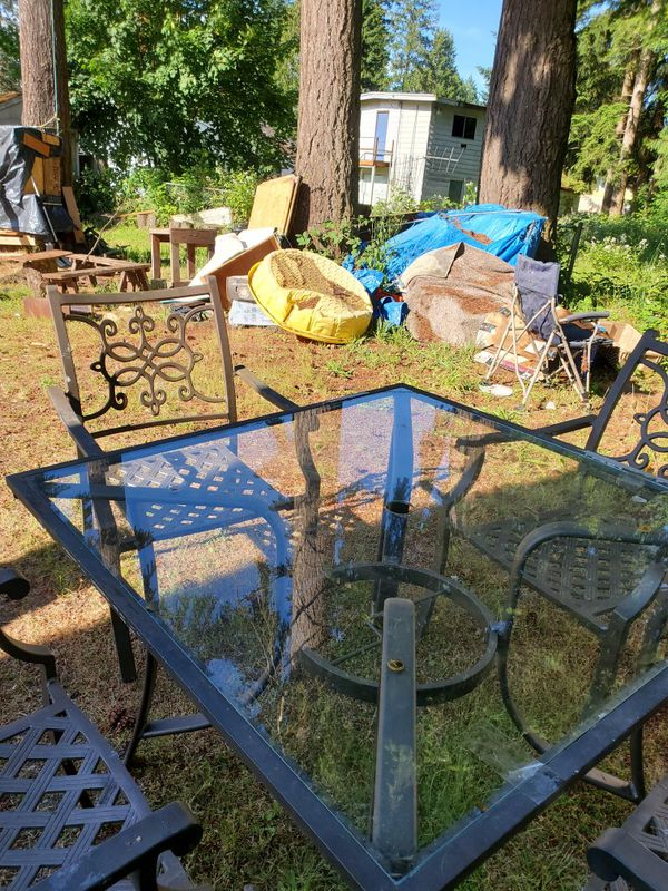 Glass table and 4 chair and umbrella
