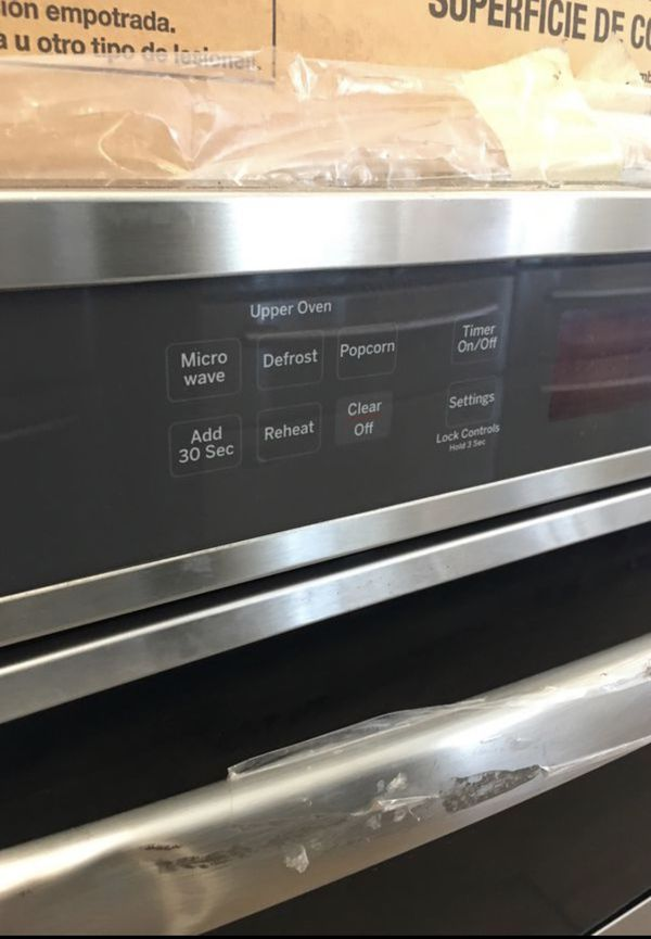 GE Microwave and Oven combo Built In Stainless Steel never used
