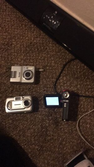 2 digital cameras an 1 digital camcorder for Sale in Caney, KS