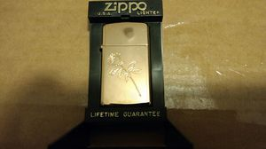 Gold tone rose engraved zippo lighter for Sale in Pflugerville, TX