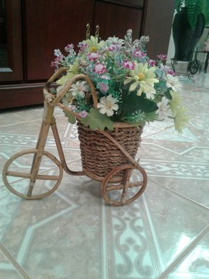 Artificial flowers in bicycle pot 12inches tall . $10 for Sale in Stockton, CA