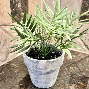 Faux Greenery In Custom Pot With Black Stone for Sale in Alpharetta, GA