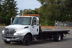 2006 International 4300 Flatbed Tow Truck for Sale in Joint Base Lewis-McChord, WA
