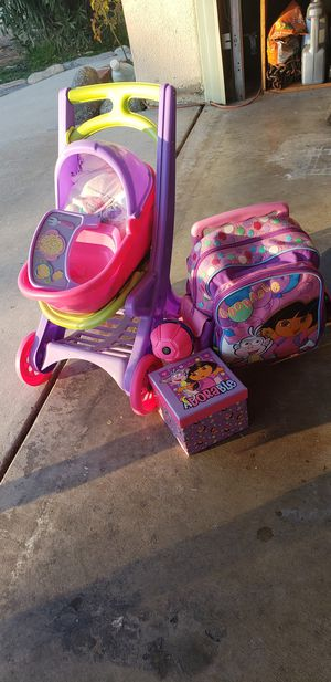 Toys, kid Stroller, Dora backpack & purse, Hello Kitty purse, Lady & tramp purse for Sale in Palmdale, CA