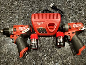 Milwaukee M12 FUEL BRUSHLESS kit, impact driver, Hammer drill , 2 batteries, charger and carrying case for Sale in Calexico, CA