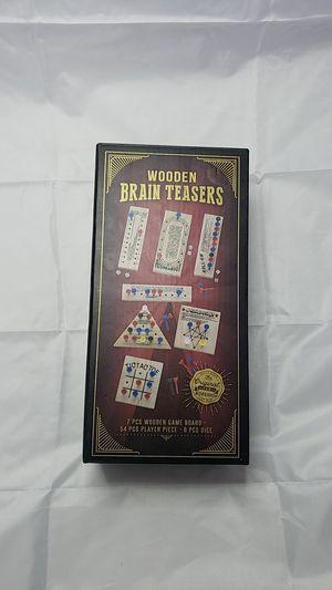 Wooden brain teasers 7 pieces wooden game board for Sale in San Bernardino, CA