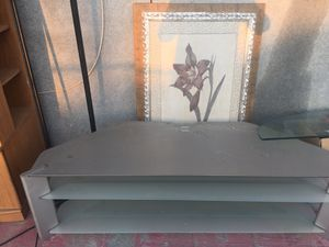 Glass tv stand for Sale in Bakersfield, CA