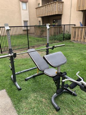 Golds gym XRS-20 adjustable Olympic weight bench with EVOLUTION 45 LB 7 FT BARBELL for Sale in West Covina, CA