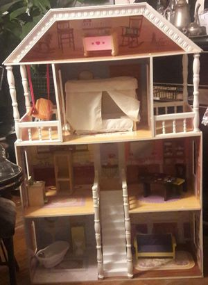 Wooden doll house almost 4ft accessories included for Sale in Philadelphia, PA