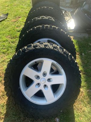 Jeep tires wheels. Shocks steering stabilizer catch all Mats and new alpine. for Sale in Duxbury, MA