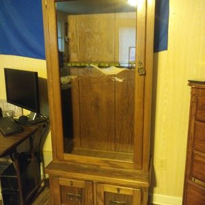 Gun Cabinet Furniture Hold 9 Long Guns & Has Extra Storage For Ammo for Sale in Marysville, WA