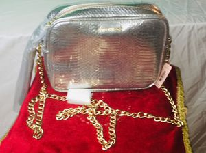 Victoria's Secret pink silver metallic crossbody tassel purse with gold chain for Sale in Brooklyn, OH