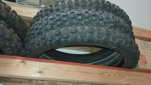 5 dirt bike tires2 front tires almost new tread 1 rear for Sale in Wenatchee, WA
