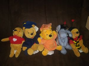With tags 4 Winnie the Pooh plush toys 1 Eeyore for Sale in Hawthorne, CA