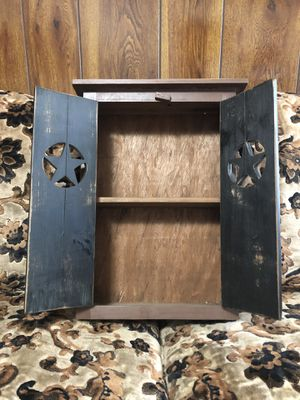 Texas star cabinet with one shelf for Sale in Riverton, UT