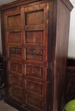 Antique rustic solid reclaimed mango wood armoire for Sale in Surprise, AZ