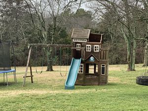 Wooden swing set/playset with swings and slide and fort for Sale in GOODLETTSVLLE, TN