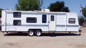31' foot travel trailer sleeps 8 air awning clean for Sale in GLMN HOT SPGS, CA