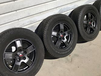 """4 Jeep Wrangler 17"""" Stock Black Wheels OEM Rims Goodyear Fortera 245/70R17 Tires At 40% Tread Balanced 5 on 4.5"""" Bolt Pattern $325 Ontario 91762 Good for Sale in Chino,  CA"""