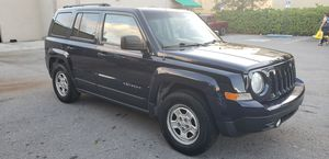 Jeep patriot 2014 rebuilt title very good condition. Real cash price only 27000 miles for Sale in Miami, FL