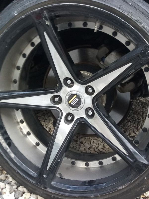 Spec-1 rims. 20x10.5. 3 good tires one still rides but there's a chunk missing which shows wire looking to trade