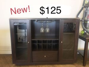 New wine hutch with glass doors shelves and drawer for Sale in Cleveland, OH
