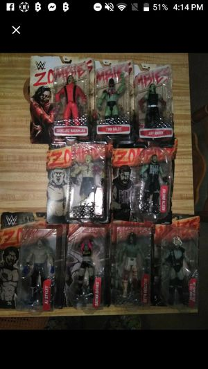 Set Of 9 WWE ZOMBIEFIED COLLECTABLE ACTION FIGURES NEVER OPENED for Sale in Tallahassee, FL