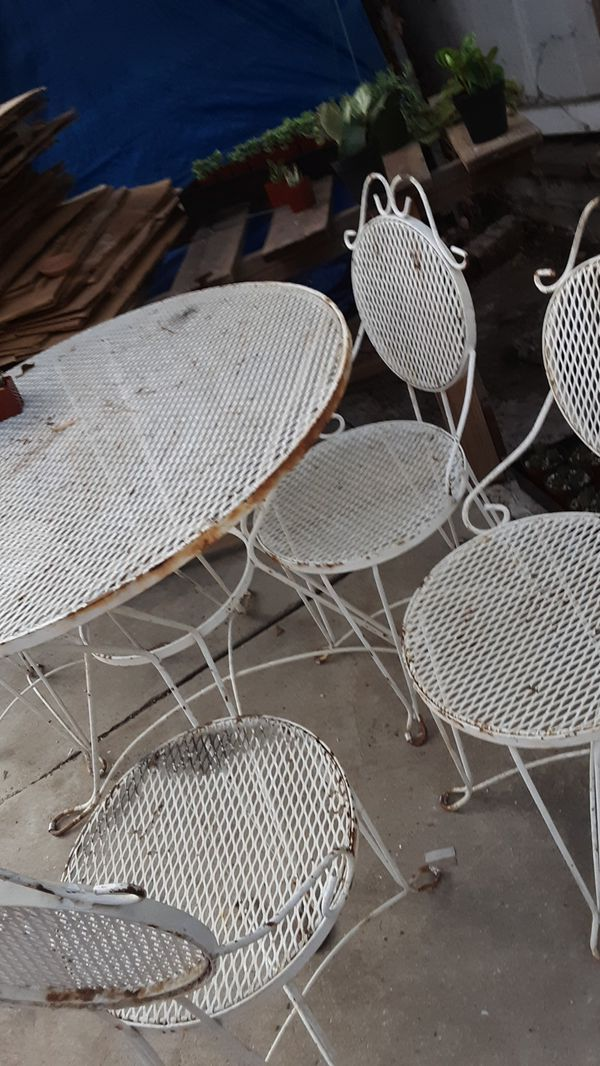 IRON GARDEN TABLE AND 4 CHAIRS SALE AS IT'S