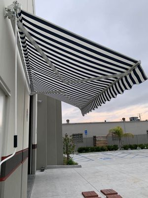 New in box Manual Patio 10 feet wide × 8' Retractable Sunshade Awning deck cover sun block canopy shade stripe navy blue and white or green stripe for Sale in Los Angeles, CA