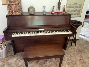 Free (must be picked up). Baldwin 806 Walnut Piano and Bench. All keys work. Great condition! for Sale in Melbourne, FL