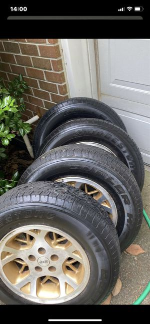 "4 Jeep wheels 16"" with 4 Bridgestone's for Sale in Virginia Beach, VA"