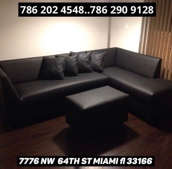 Black leather sectional sofa never used!!
