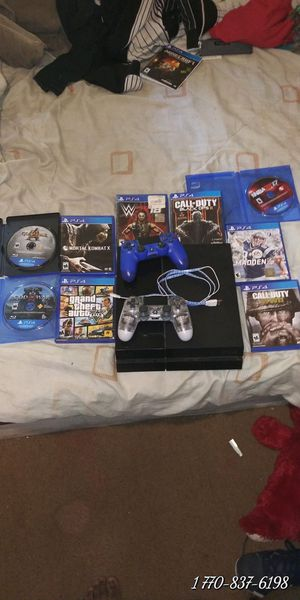 Ps4 with nine games 2 controllers and charger for Sale in Atlanta, GA