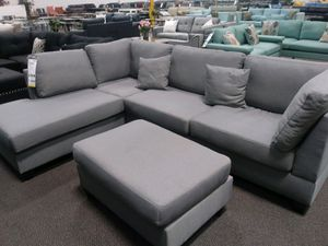 Grey sectional sofa ( ottoman included) reversible chaise for Sale in Long Beach, CA