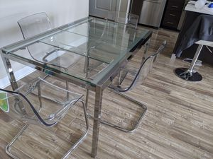 Expandable glass dinning table and chairs for Sale in Dulles, VA